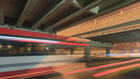 Traffic in motion blur at underpass at night in Beijing, China. Night scene with an underpass and traffic in motion blur, Beijing, China Stock Photography