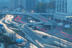 Traffic with motion cars on multilevel highway Stock Photos