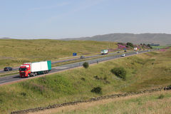 Traffic on motorway in countryside, Cumbria. Stock Image
