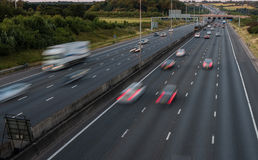 Traffic on the motorway at the dusk time. Traffic on the motorway at the evening time royalty free stock photo