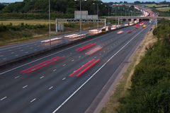 Traffic on the motorway at the dusk time. Traffic on the motorway at the evening time stock photo