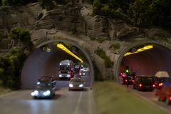 Traffic in the mountain tunnel in miniature royalty free stock photos