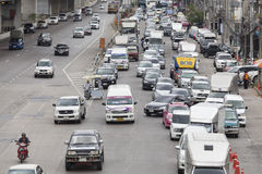 Traffic moves slowly along a busy road in Bangkok. Royalty Free Stock Images