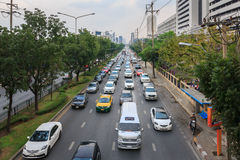 Traffic moves slowly along a busy road Stock Images