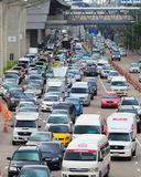 Traffic moves slowly along a busy road. Stock Image