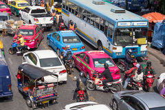 Traffic moves slowly along a busy road in Bangkok, Thailand. Stock Photography