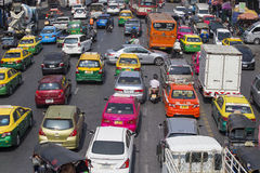 Traffic moves slowly along a busy road in Bangkok, Thailand. Royalty Free Stock Images