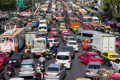 Traffic moves slowly along a busy road in Bangkok, Thailand. Stock Images