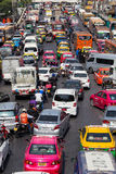 Traffic moves slowly along a busy road in Bangkok, Thailand. Royalty Free Stock Photography