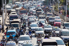 Traffic moves slowly along a busy road in Kathmandu, Nepal Stock Photos