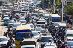 Traffic moves slowly along a busy road in Kathmandu, Nepal Royalty Free Stock Photography