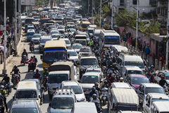 Traffic moves slowly along a busy road in Kathmandu, Nepal Royalty Free Stock Image