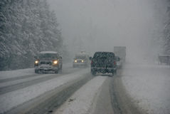 Traffic moving through fog and snowstorm Royalty Free Stock Photo