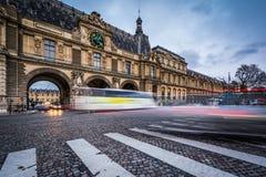 Traffic moving past the Porte Des Lions, in Paris, France. Stock Photo
