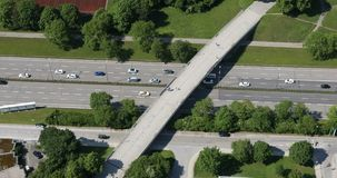 Traffic in Munich, aerial view. Aerial view of a six lane street in central Munich, Germany. Relatively light traffic with a pedestrian bridge crossing the road stock footage