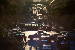 Traffic on 42nd Street through Midtown Manhattan at rush hour Stock Photo