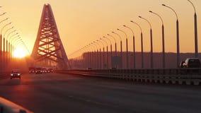 Traffic on New Bugrinsky Bridge at Sunset, Novosibirsk, Russia stock video
