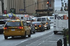 Traffic in New York make it hard for an ambulance to get through. AN ambulance makes its way through a crowded street in New York city royalty free stock image