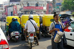 Traffic and newspaper seller in India Stock Photos