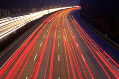 Traffic at night. Night time traffic on highway Royalty Free Stock Images