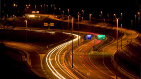Traffic by night Stock Photos