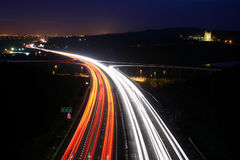 Traffic At night. Rush hour traffic shot from above a busy road Night photo of motorway showing streaking trails of light Stock Photos
