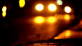Traffic at night with blurry background and bokeh.  stock footage