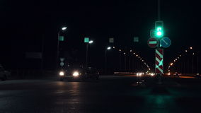 Traffic in the night city. A wide road with traffic lights stock footage