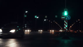 Traffic in the night city. A wide road with traffic lights stock video