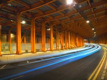Traffic Night in curve at Yellow Tunnel Stock Photo