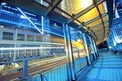 Traffic night and footbridge Stock Photo