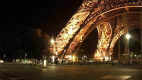 Traffic at night in front of the Eiffel tower timelapse Paris, France stock video