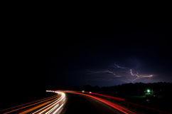 Traffic at night with lightning Royalty Free Stock Image