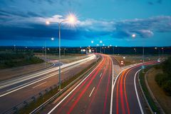 Traffic at night. Lights of the cars and trucks on the highway. Prague, Czech Republic Royalty Free Stock Images
