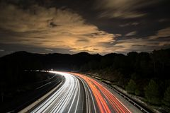 Traffic at night in the mountain. Beautiful nightscape. Long exposure shot royalty free stock photography