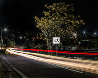 Traffic at night and school sign Stock Image