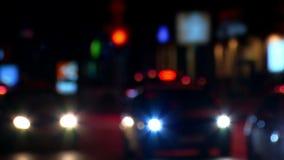 Traffic in night street. Defocused blurs from cars. Blurs car defocused night background. Circle bokeh stock video footage