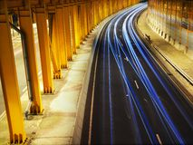 Traffic Night in Yellow Tunnel Royalty Free Stock Image