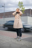 Traffic noise and woman. Mature woman with hands at the ears because of the loud noise of the street in the city Royalty Free Stock Images