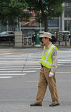 Traffic officer are controling street motion in. Shanghai, China - July 2, 2015: traffic officer are controling street motion in Shanghai Royalty Free Stock Photos