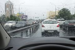 Traffic On The Rainy Day At The City Street. Royalty Free Stock Image