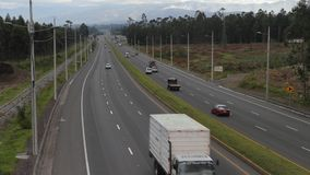 Traffic on the Pan-American Highway in Ecuador. Cotopaxi, Ecuador - May 10, 2019: Traffic on the Pan-American Highway, a wide section south of Quito stock footage