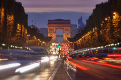 Traffic in Paris, Arc de Triomphe. Paris, Champs-Elysees traffic at night with blur moving cars Stock Image
