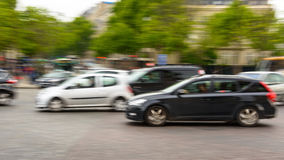 Traffic in Paris. Traffic with motion blur at Place de L'Etoile in Paris, France Stock Images