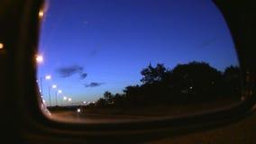 Traffic passing at night.Car mirror view stock video