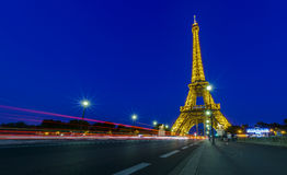 Traffic passing Pont d'lena in front of Eiffel tower Stock Photos