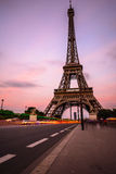Traffic passing Pont d'lena in front of Eiffel tower Stock Images