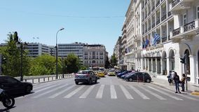 Traffic Passing Syntagma Square, Athens CBD, Greece. Traffic including many yellow taxis passing Syntagma Square Constitution Square and luxury hotels in central stock footage