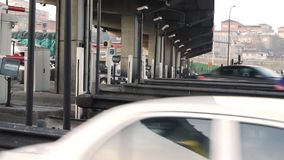Traffic passing toll booth stock video