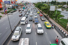 Traffic. Pathumthani,Thailand-August 16,2014 : Evening busy traffic in motion blur car at Ransit road in Pathumthani , Thailand Royalty Free Stock Photo